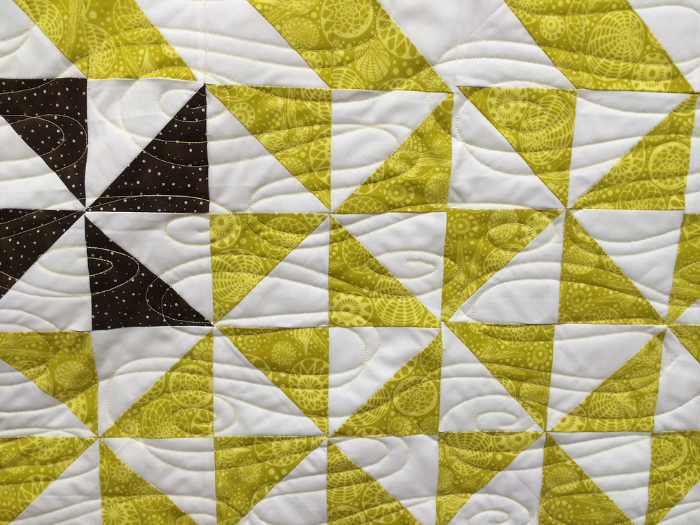 Swirls Quilting Pattern on Chevrons and Pinwheels Quilt by Sue Lindsay