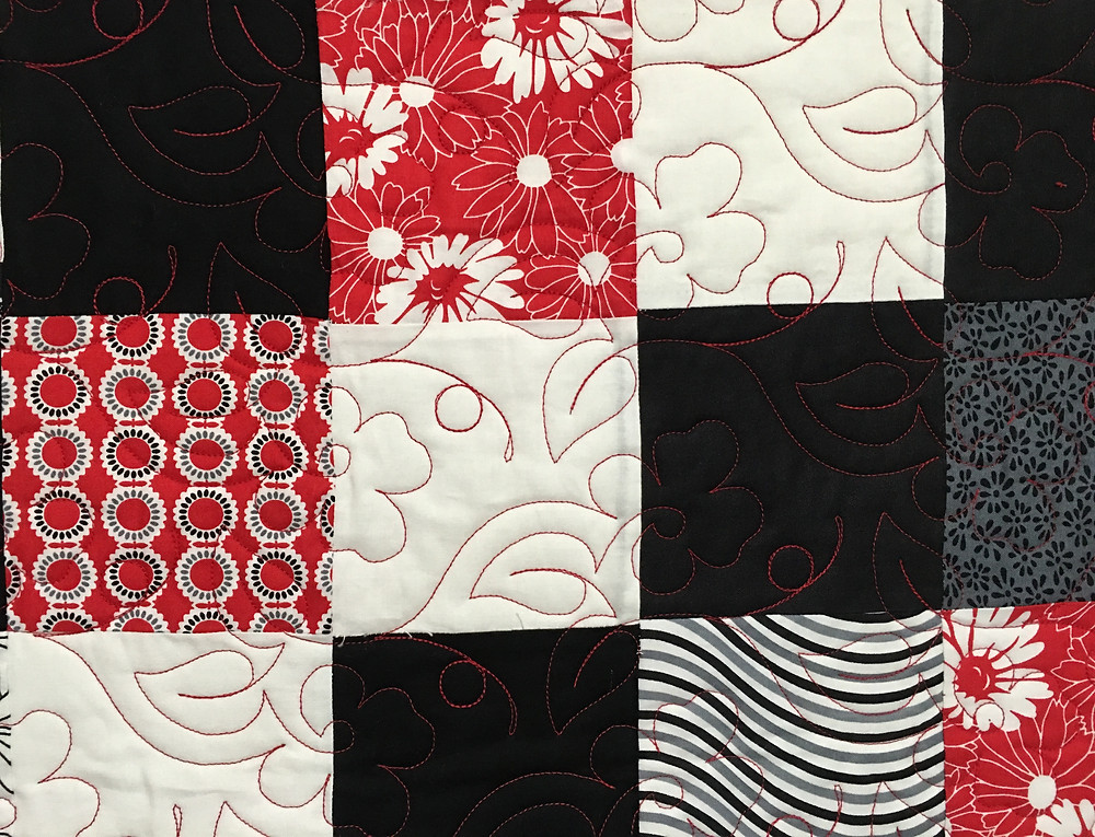 close up of Red and Black Charm Pack by Wendy Bell