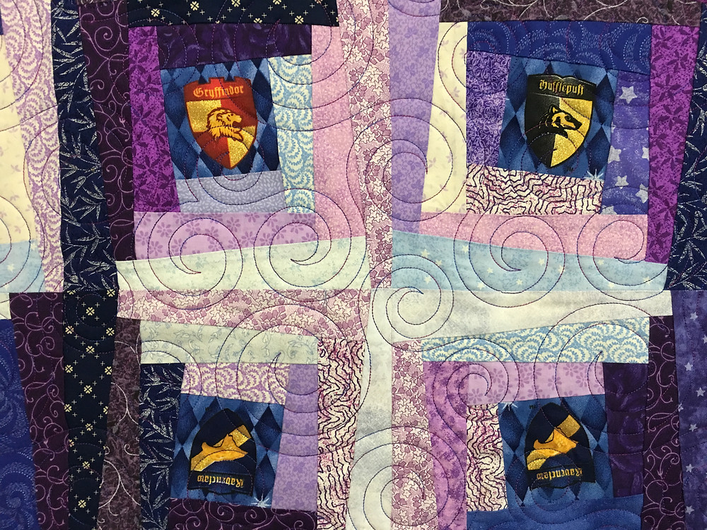 closeup of circles quilting pattern on Harry Potter Magical Log Cabin Quilt