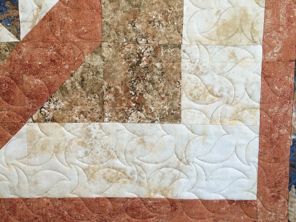 closeup of dancing leaves quilting design