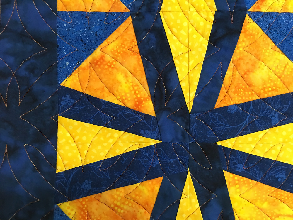 Geometric quilting pattern on Fractured Kaleidoscope quilt by Lisa Fahlquist
