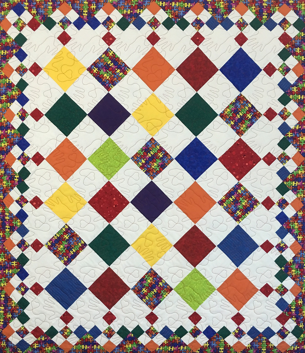 Diamond Patchwork Quilt by Roxanne Darnell