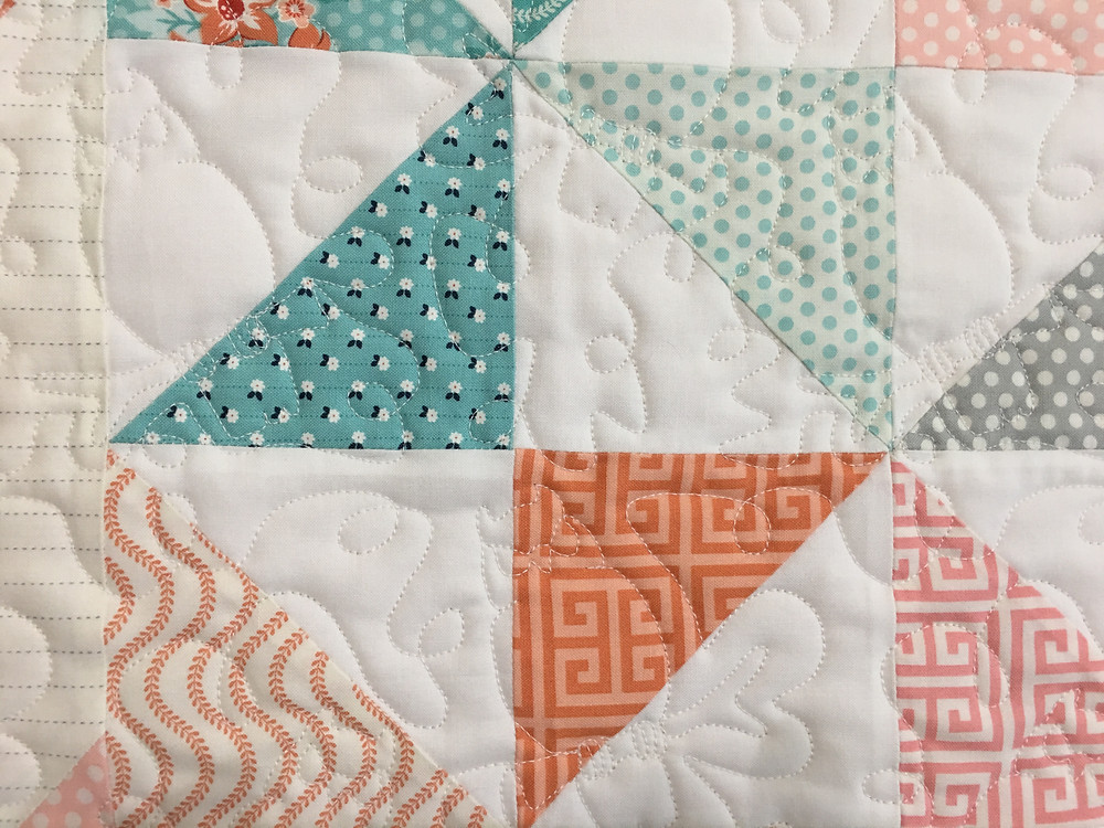 Animal Quilting Pattern on Pinwheels Quilt by Laura Murray