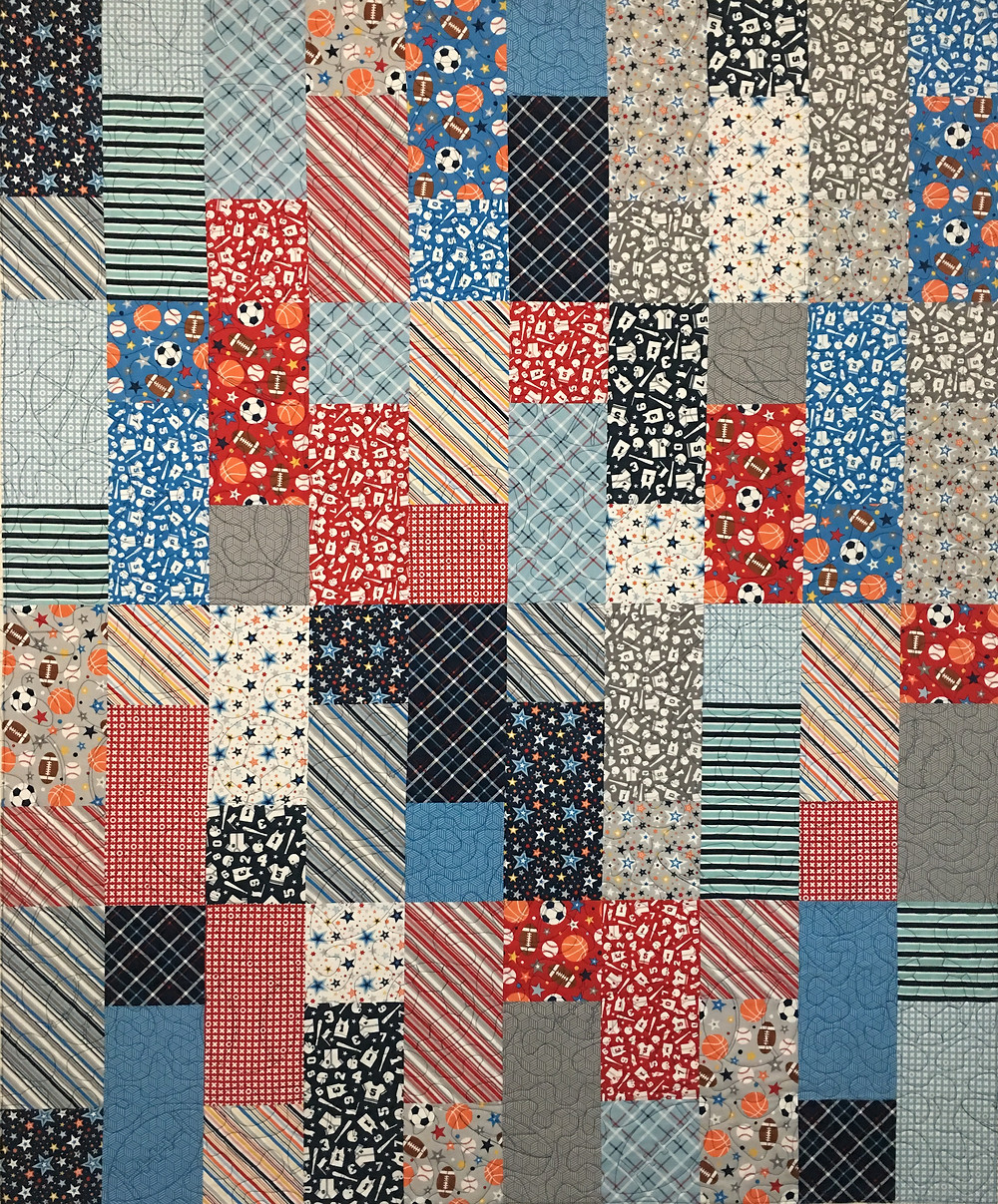 Jelly Roll Sports Theme quilt by Delfina Guerra