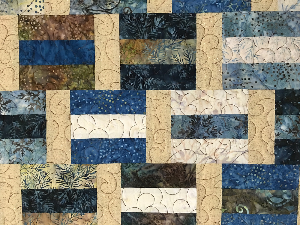 close up of Neida Savage Stacked Blocks Quilt
