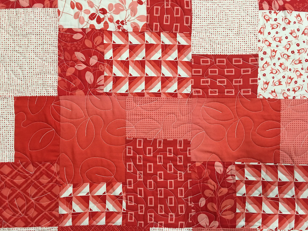 Close up of Wendy Red Squares Quilt