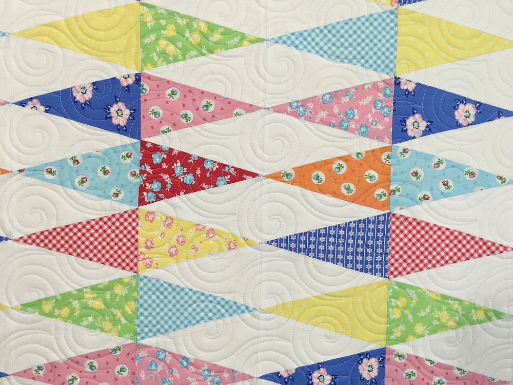 closeup of Melissa Kite Tails Quilt in pretty pastels