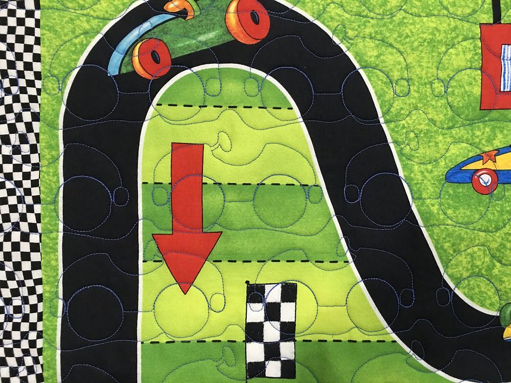 third closeup of Jeri Couthen Racing Car Quilt