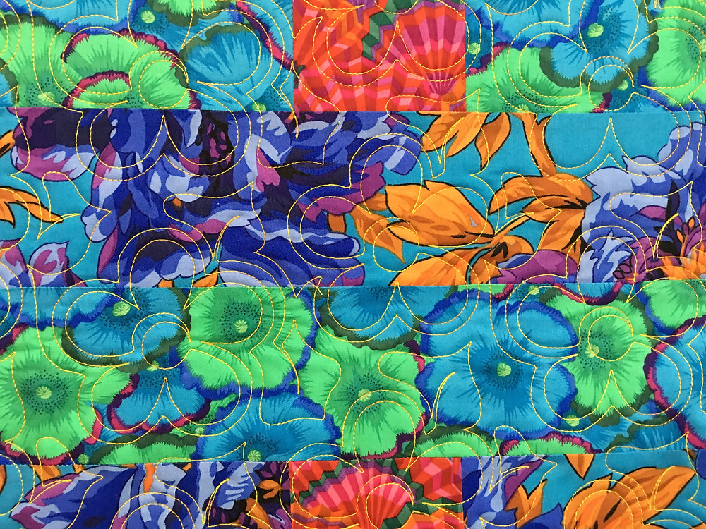 close up of the quilting pattern on Delfina Guerra Villa Rosa quilt