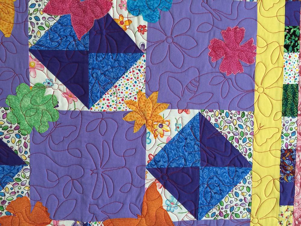 Close up of  Jennifer Adams Bright Flowers and Butterflies Quilt