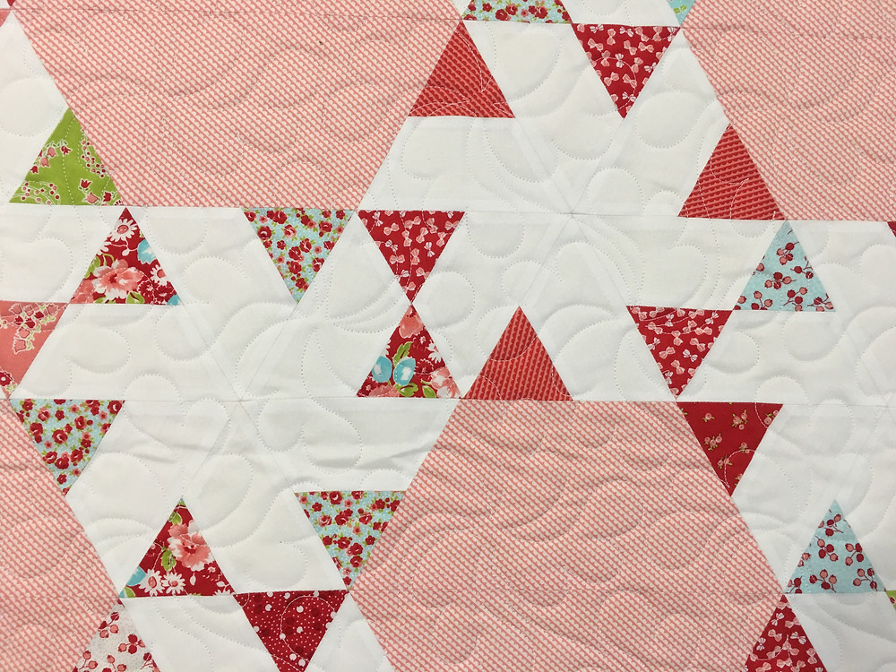 Feather quilting pattern on Ruby 2 Bonus Quilt by Delfina Guerra