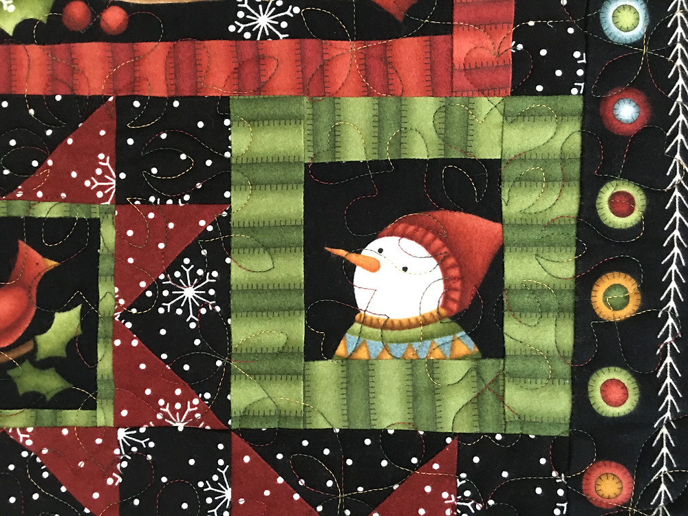 Snowflakes quilting pattern on Crazy for Christmas Quilt by Leslie St.Onge