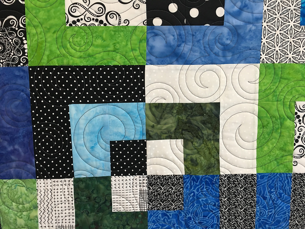 Circle Quilting Patternon Bento Box Quilt by Nancy Nesbaum
