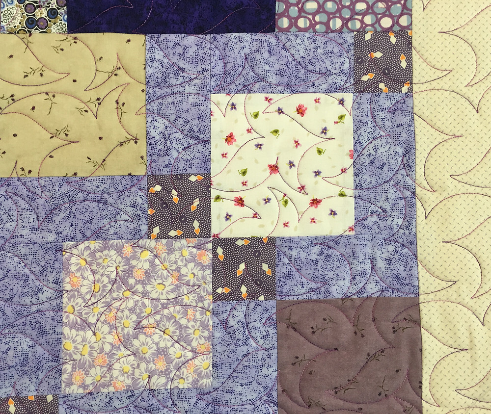 Leaves quilting pattern on Purple nine patch quilt by Cindy Lovelace