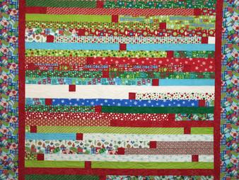 Delfina Guerra Christmas Jelly Roll Quilt