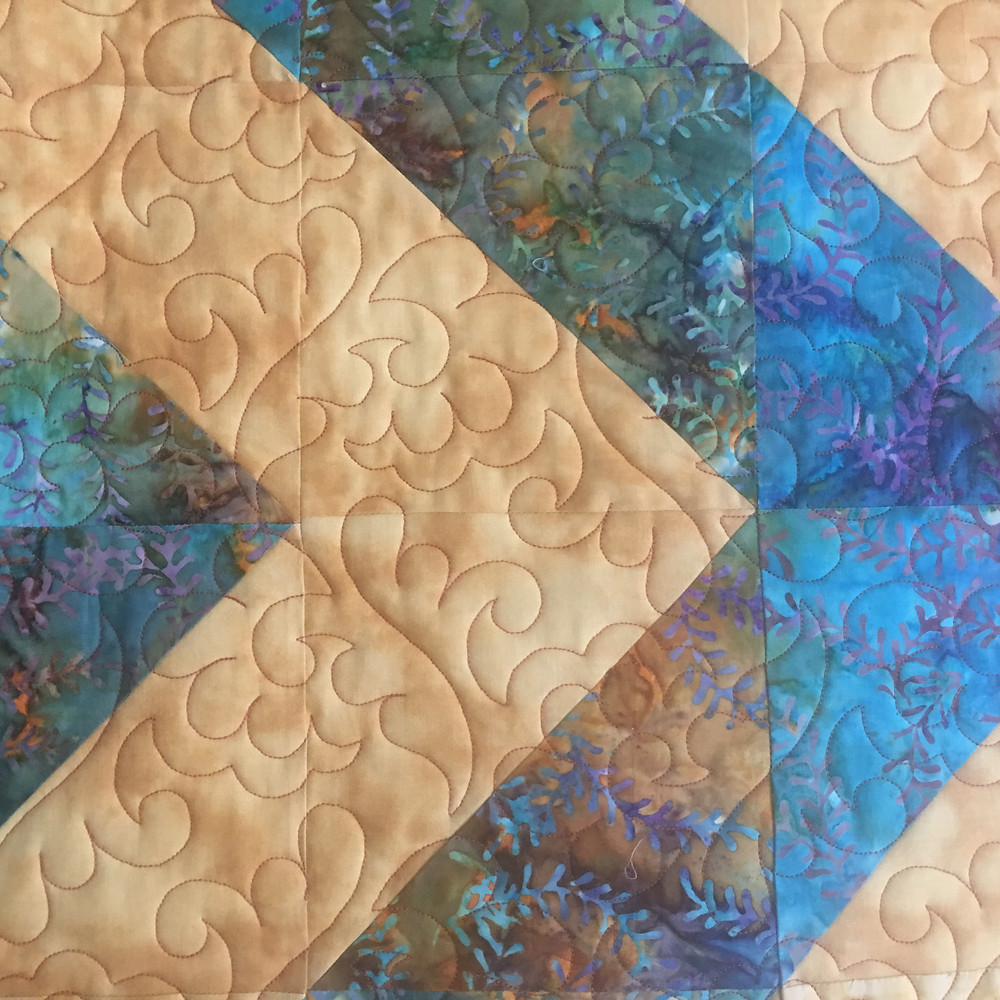 Feather Quilting Pattern on Her Own Original Quilt by Peggy Krebs