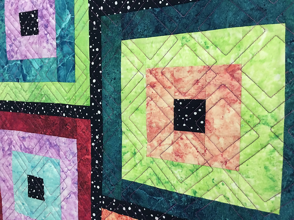 Geometric Quilting Pattern on Log Cabin Quilt