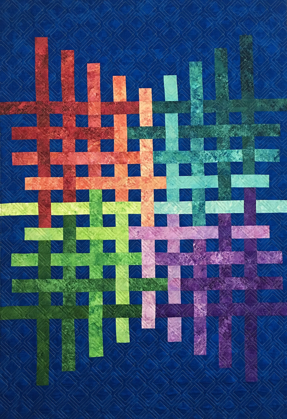 Laura's truly Modern Quilt in a blue background