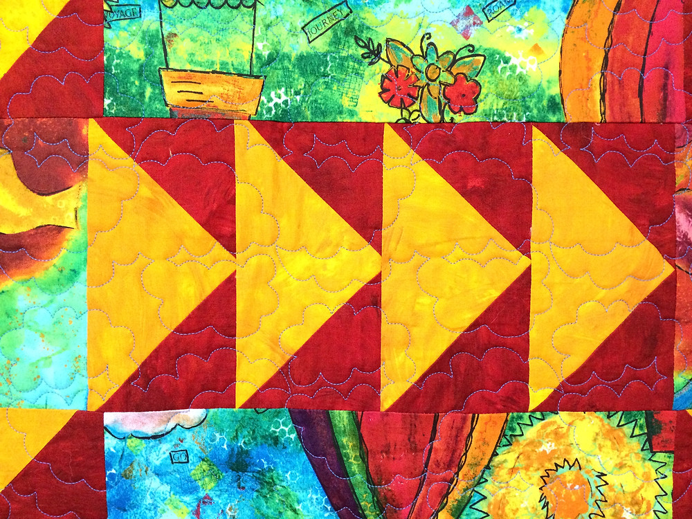 flying geese border on balloon quilt