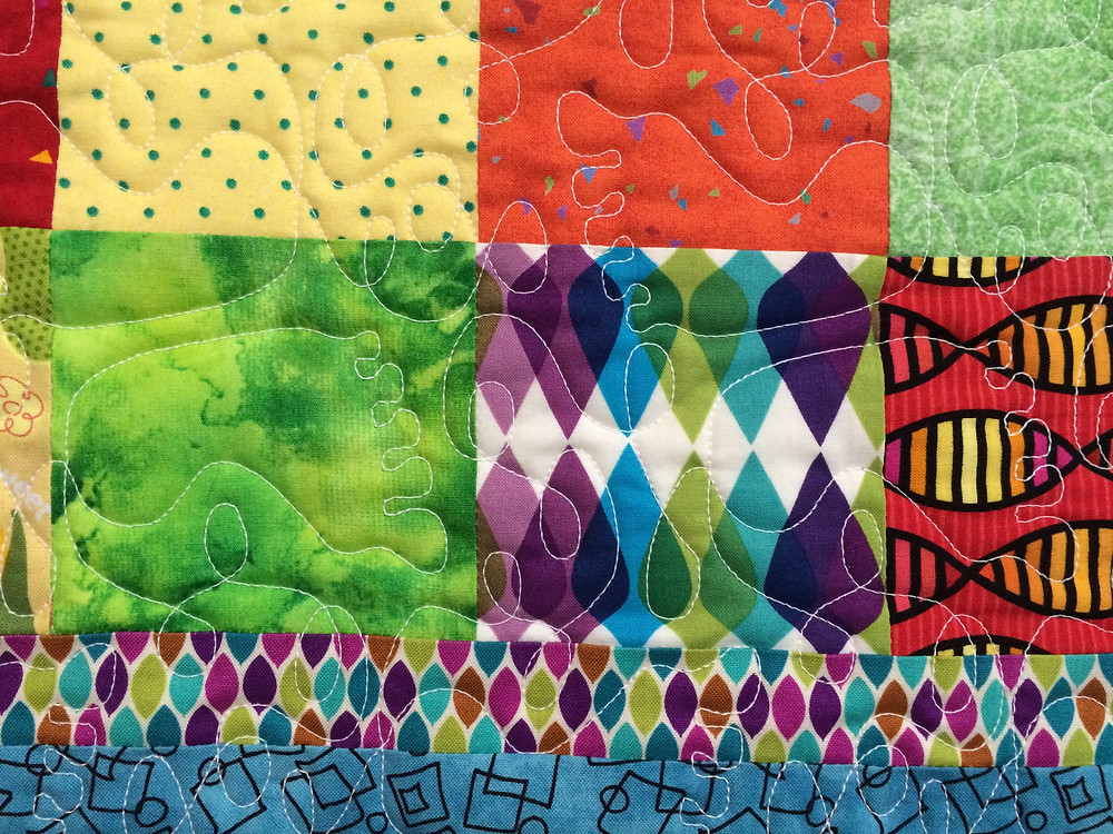 closeup of colorful blocks on baby quilt