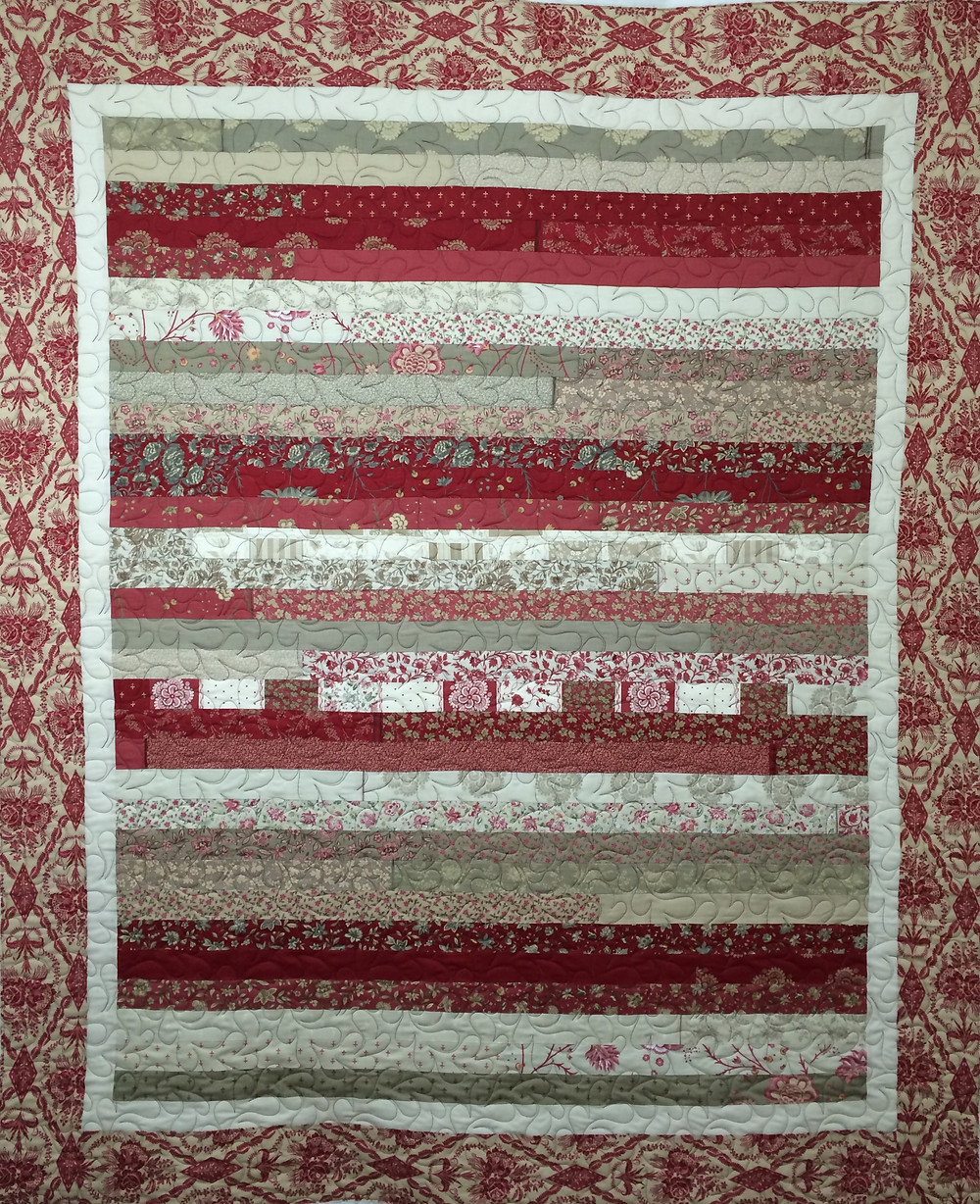 shades of red jelly roll quilt