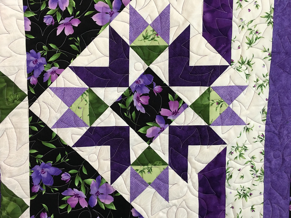Another closeup of Flowers Quilting Pattern on Stars Among the Violets Quilt by Pam OKane