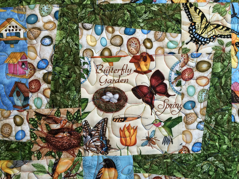 closeup of birds and butterfly quilt