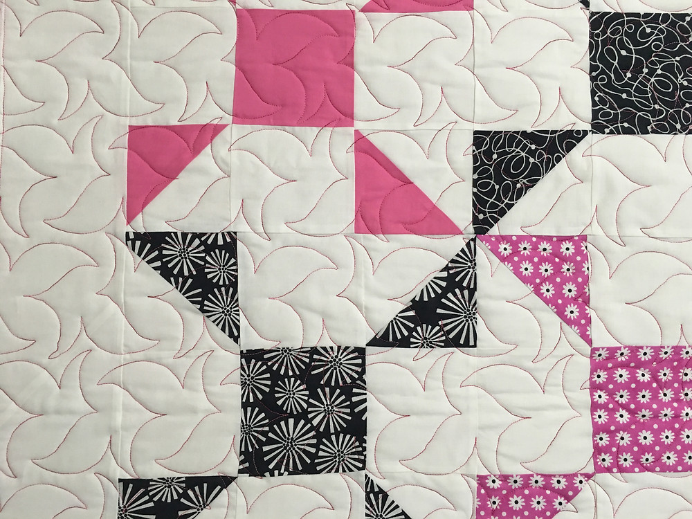 closeup of quilting pattern on Nancy Thornton's Pinwheels with a Twist Quilt