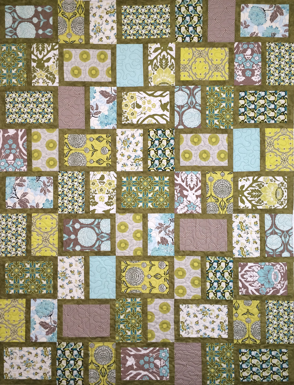 Jill Olive, yellow and blue blocks quilt