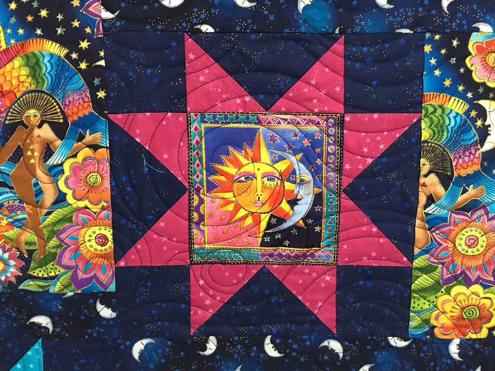 Circles quilting pattern on Laurel Burch quilt by Sheils Stuckey