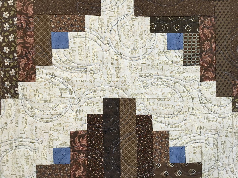 close up of horseshoe quilting pattern on Nancy Brinkley's Quilt