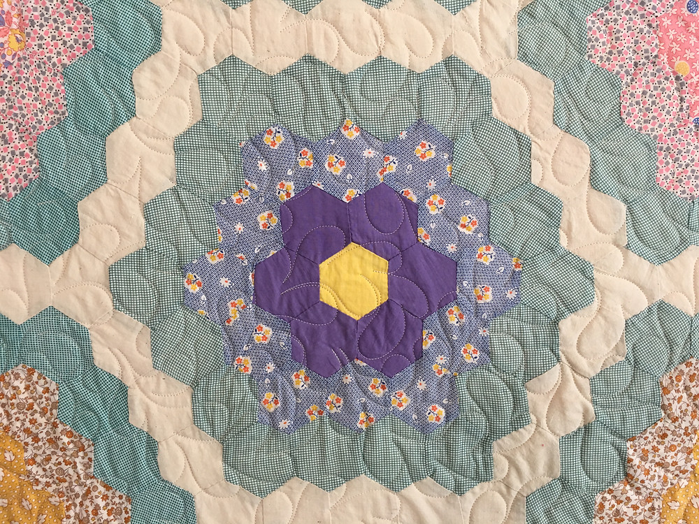 quilting pattern of feathers on Antique Hexagon Quilt by Dyanna Eastwood