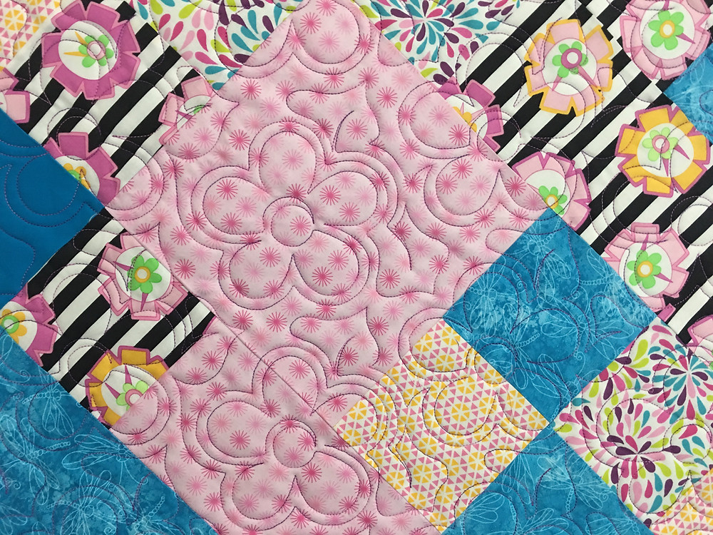 Flowers Quilting Pattern on Scrappy Blocks Quilt by Charlene Lancaster