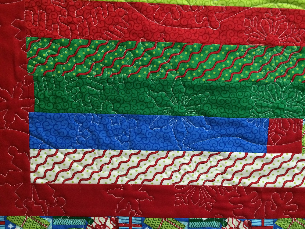 another close up of Delfina Guerra Christmas Jelly Roll Quilt