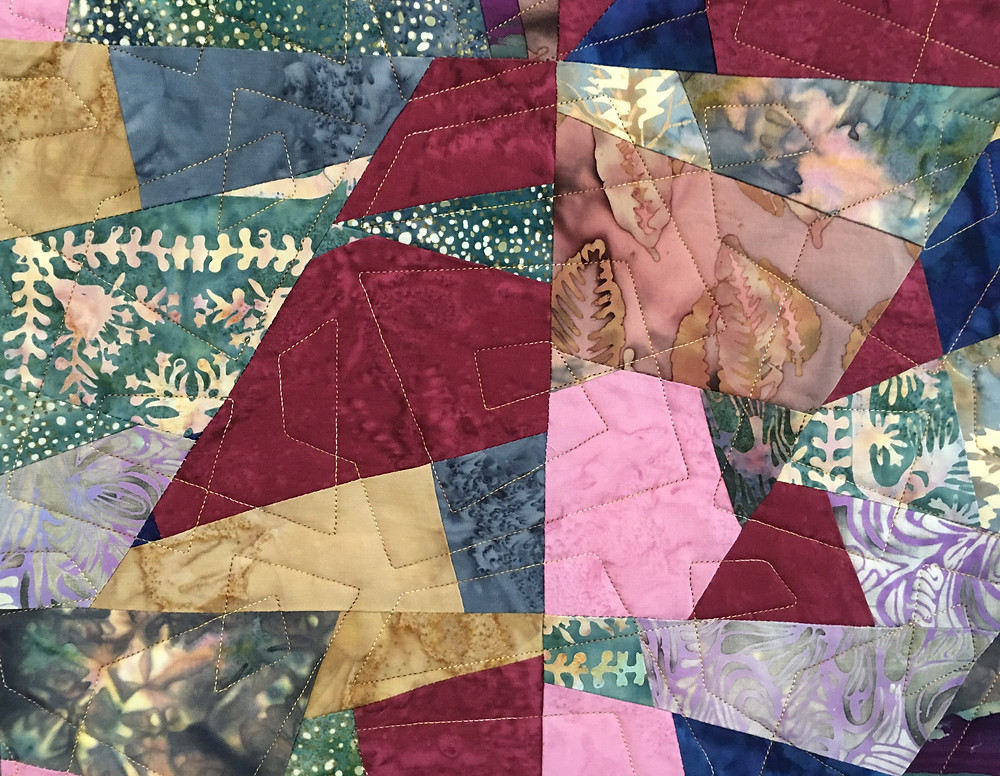 closeup of the Geometric Quilting on Annie's Qult