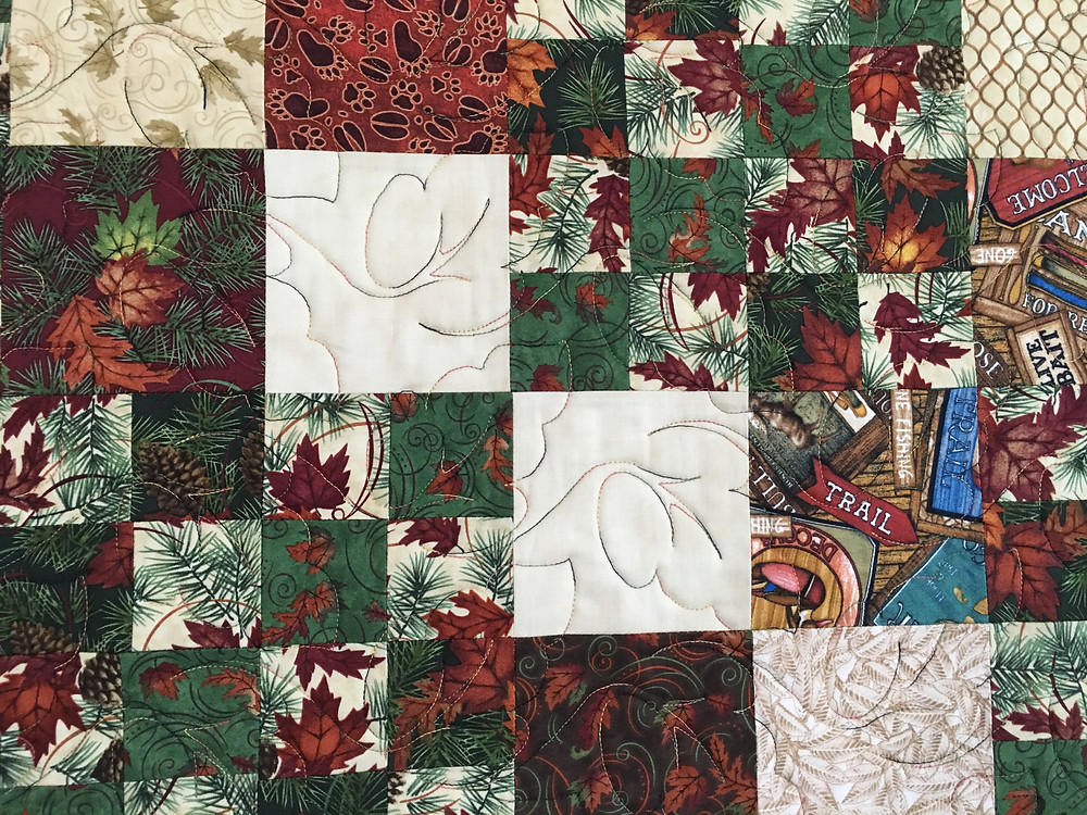Closeup of Leslie St.Onge Wildlife Quilt with squares in a square