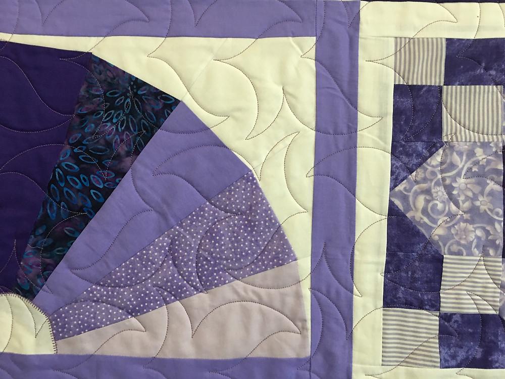 Swirl Quilting Pattern on Sampler Blocks in Purple Quilt by Billie Murphy
