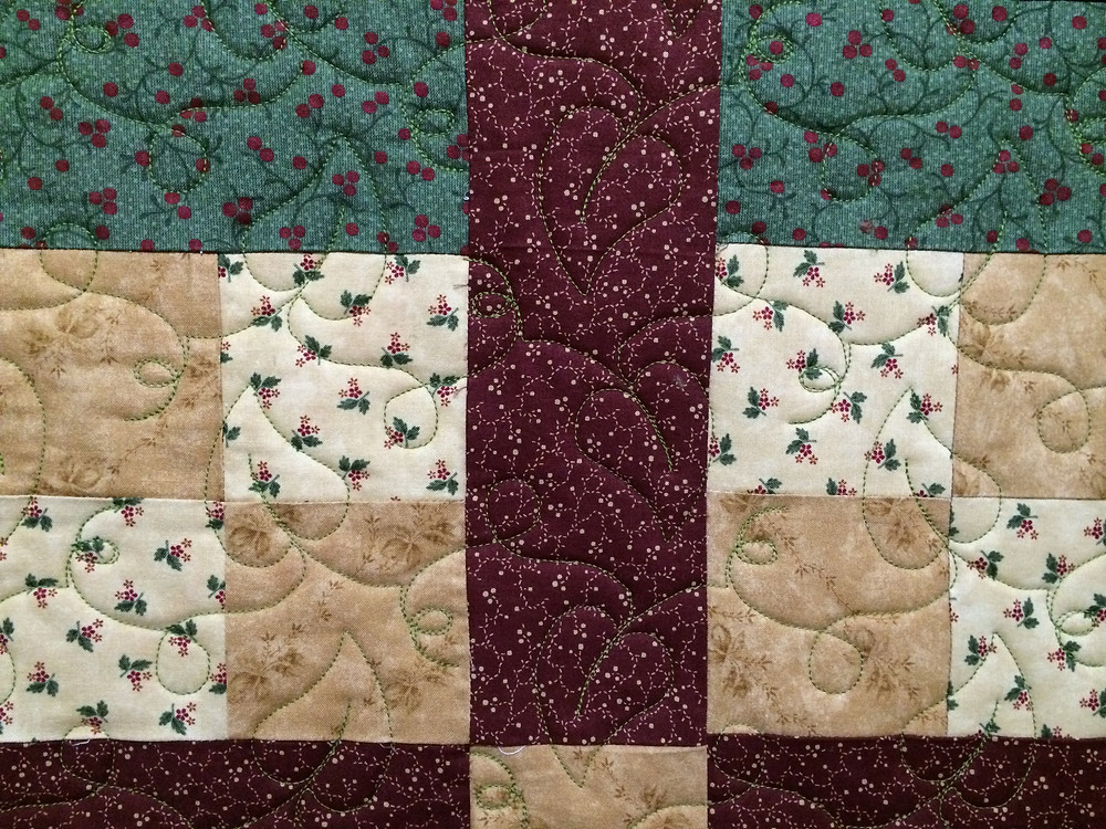 leaf quilting pattern on fall color quilt