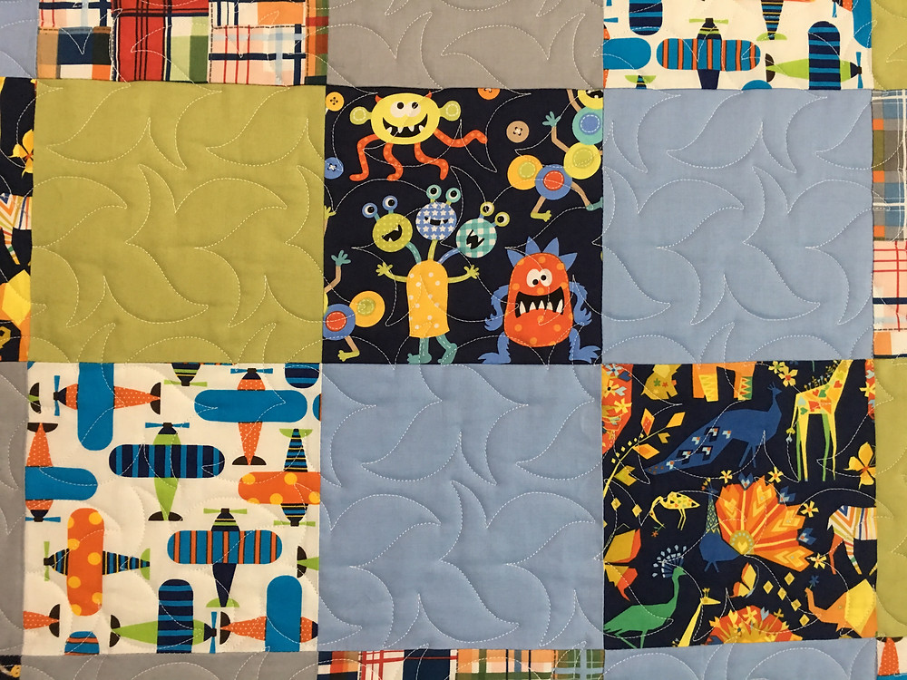 swirls quilting pattern on Monsters Planes and Animals Quilt by Anna King