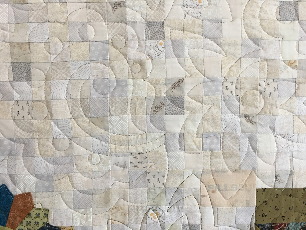 Paisley Quilting Pattern on Small World Quilt by Jill Seward