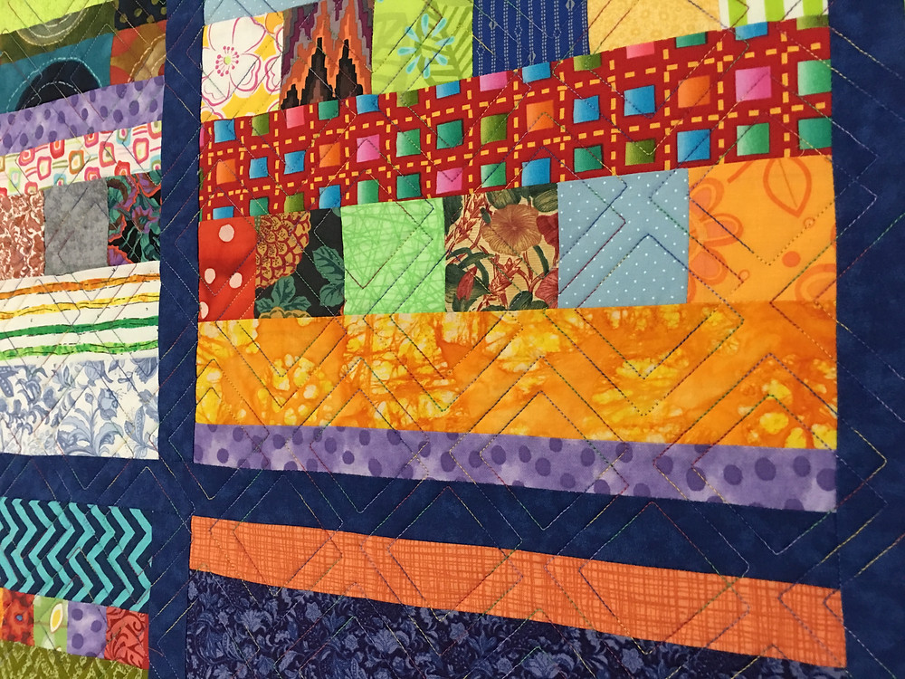 Geometric quilting pattern on Blocks and Bars Quilt by Laura Wetzel