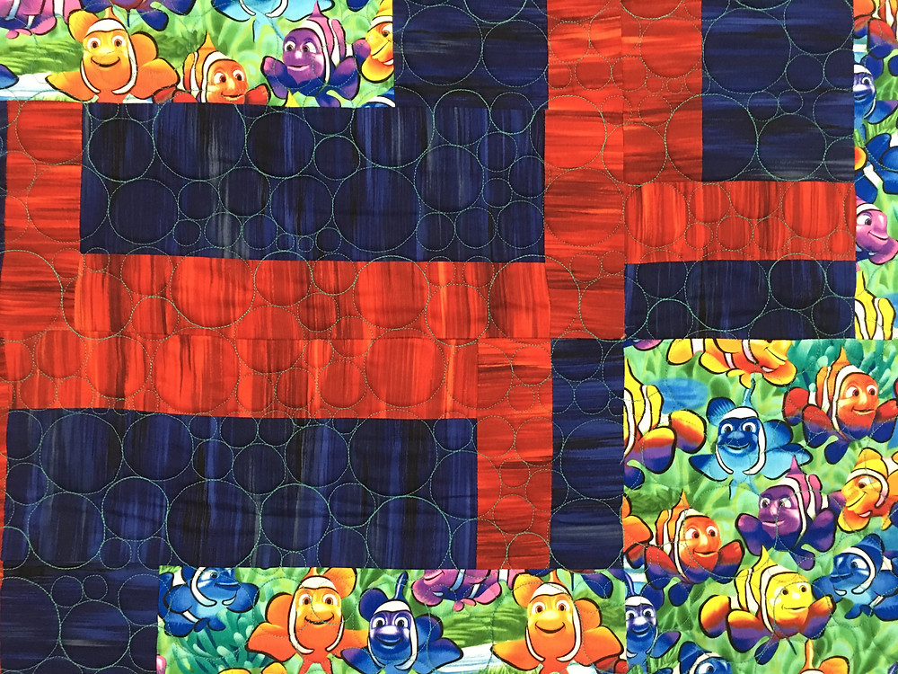 close up of Nemo Fish Baby Quilt by Beth Robertson