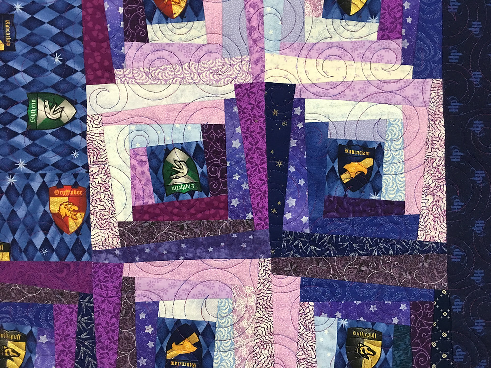 Circle quilting pattern on Harry Potter Magical Log Cabin quilt by Sandra Mitchell