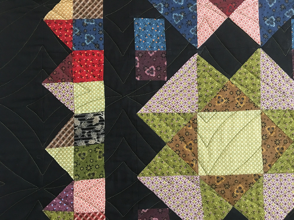 Geometric Quilting Pattern on Prim and Dandy Quilt by Cynthiz Parra