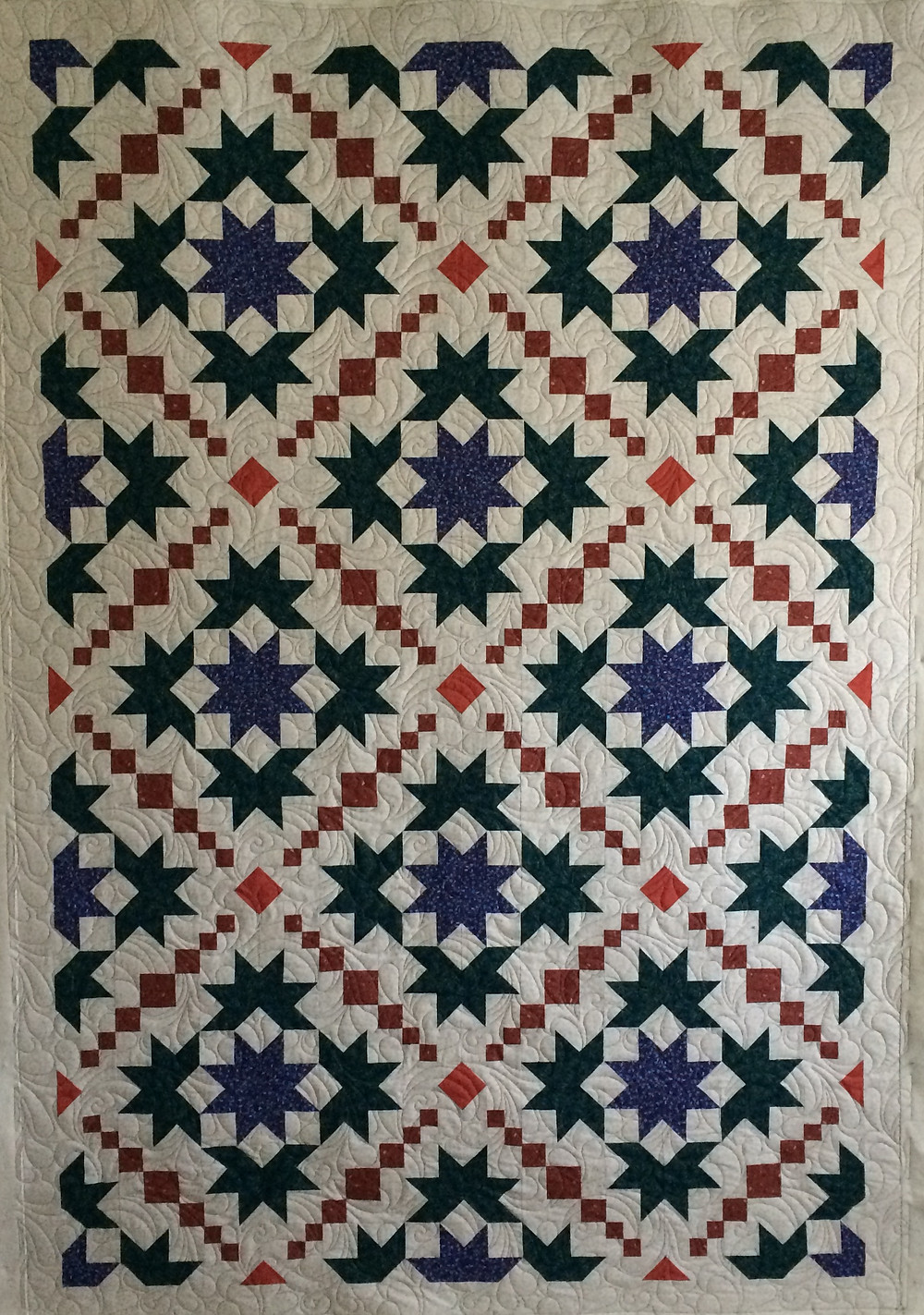 star quilt with floating diamonds