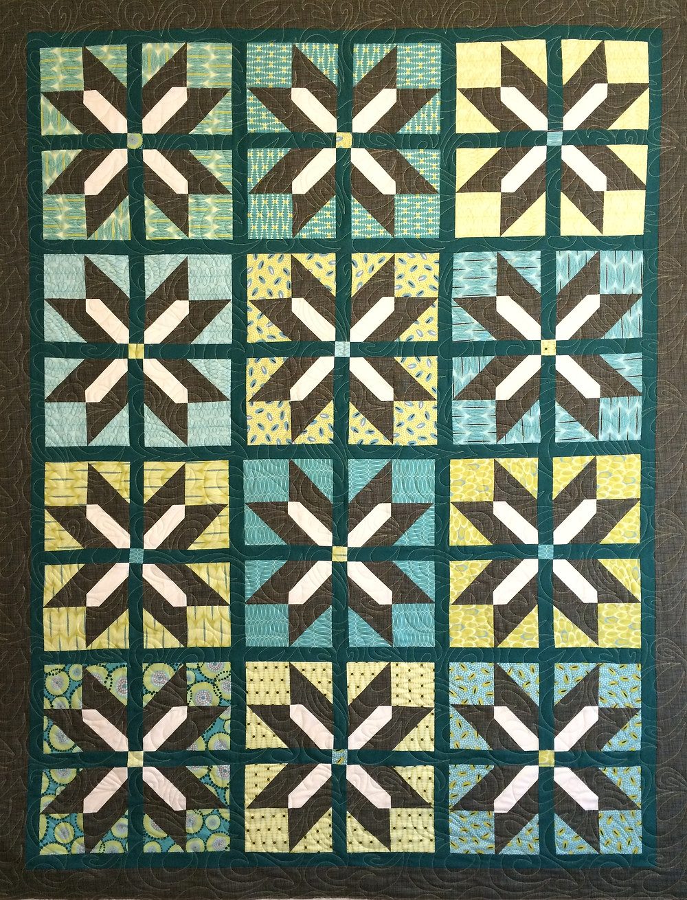 A For You Quilt in shades of teal and yellow