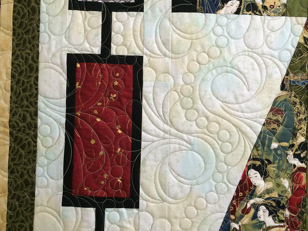 formal kimono quilt with the feathers and pearl quilting design