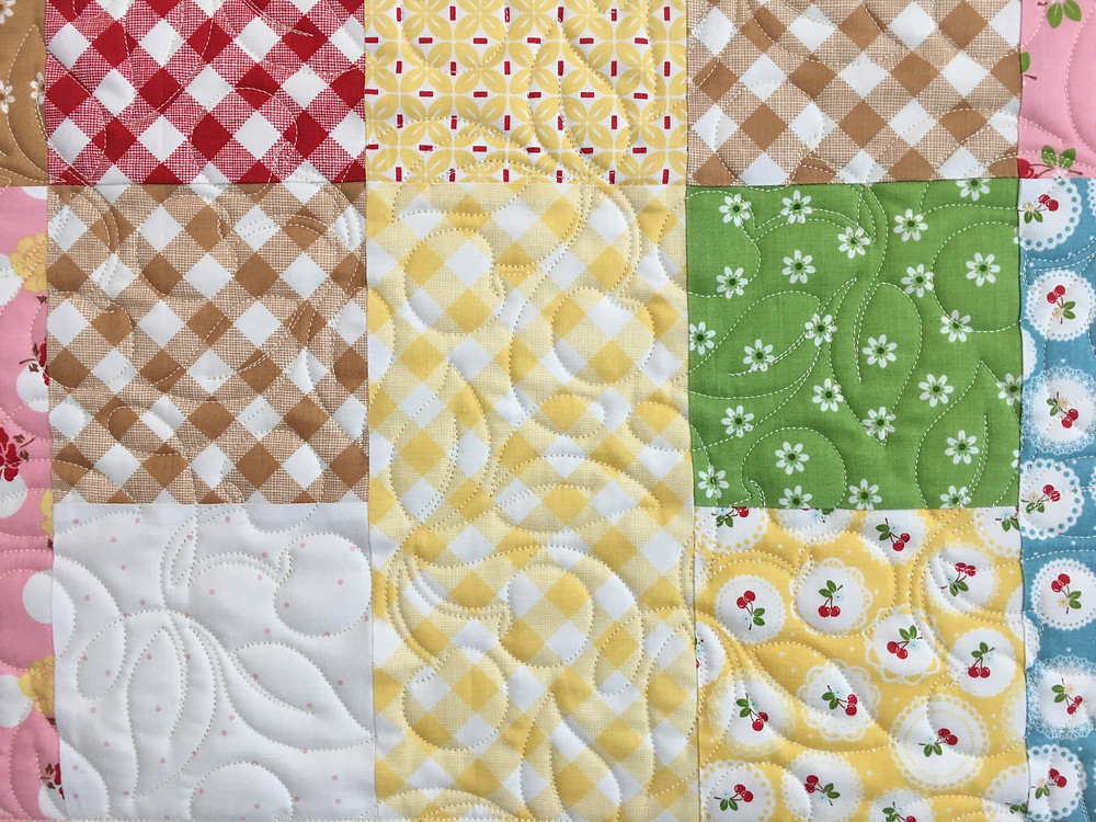 Flowers Quilting Pattern on Scrappy Table Runner by Delfina Guerra