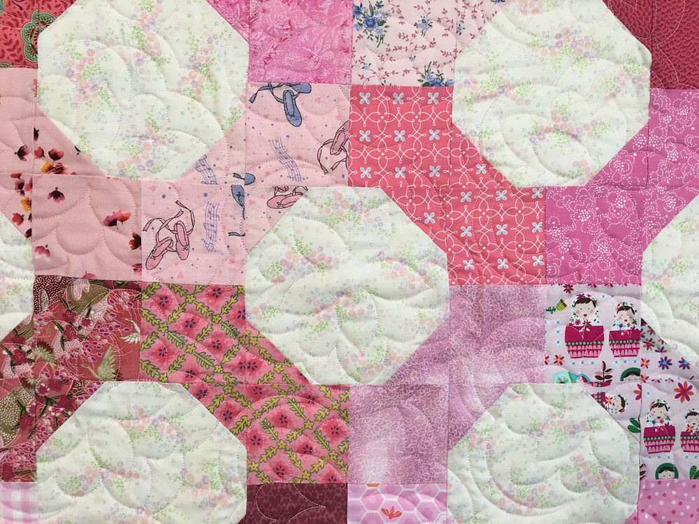 close up of Cheryl Pink and White Bowtie Quilt