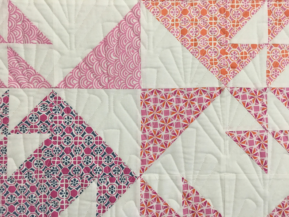 Quilting pattern on Half Square Triangles Double T quilt by Jocelyn Ueng